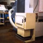 MistBuster 500 next to Mazak machine tool